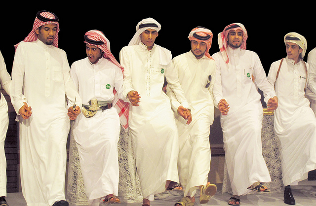 Saudi boys in a brilliant dancing pose - Image by Tribes of the World