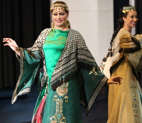 A model wears fashion from Iraqi folklore during celebrations in Baghdad for International Women Day