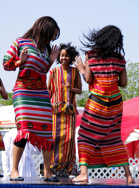 Eritrean girls dancing in traditional outfits. Image by Kurt Bauschardt