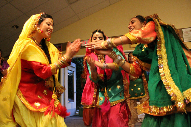 Giddha is performed by Punjabi women who are particularly dressed in bright colored fascinating costumes. Image by University of the Fraser Valley