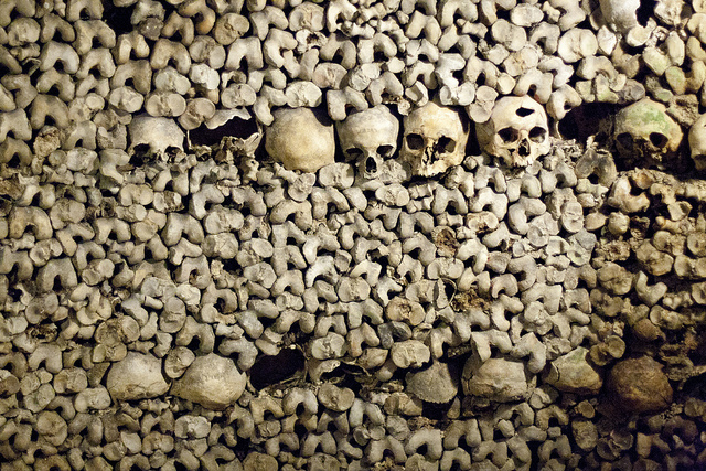 Stack of Skulls in Catacombs of Paris - Photo by San Diego Shooter